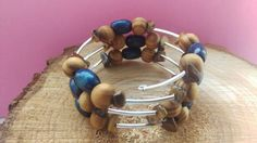 Wire wrap bracelet with wooden beads and tigers eye chips.