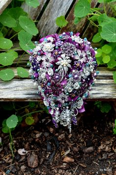 Cascading purple and teal wedding bouquet made to order by Noaki