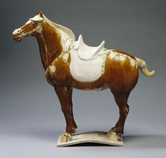 Horse  Chinese, Tang dynasty, 618- 907  Earthenware with sancai glaze  h. 24 3/8 in. (62 cm); w. 24 1/2 in. (62.3 cm); d. 7 ½ in. (19 cm)  Gift of Lenora and Walter F. Brown, 82.174. Photograph by Peggy Tenison