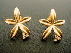 Venus's LookingGlass flower studs in gold by wishbee on Etsy, $16.50