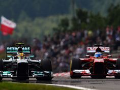 Hamilton passes Alonso on his way to Pole Position for the German Grand Prix