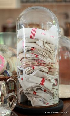 Great way to display vintage tea towels! (OR vintage lace hankies~