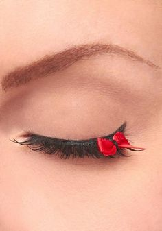 Fake eyelashes with a red bow at the end! What the heck?!?!?!
