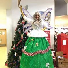 Christmas Tree Fairy for hire. Our Christmas Tree Fairy stilt walker is available to book for Christmas-themed events, Christmas parades or shopping centre events in London & the UK.