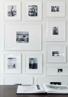 A really serene way of displaying your family portraits - white frames and mounts highlighting the monochrome prints. Very stylish.