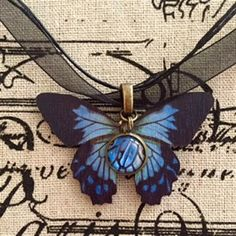 "Blue Morpho Wood Butterfly Glass Cabochon Ribbon Pendant created by Karen Minkel for ""Fly To Me"" at flytomeshop.etsy.com $15.95 each."