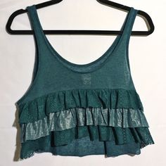 FREE PEOPLE teal ruffle waterfall crop In great condition. The first pic is the back (since it's the most exciting part haha). No stains or tears. Free People Tops Crop Tops
