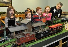 The Hinamon family of Charleston checks out the Kanawha Valley Railroad Club's model display at the club's facility at Coonskin Park Sunday. The club also had vendors of new and used model railroad equipment as well as layouts in several different scales.
