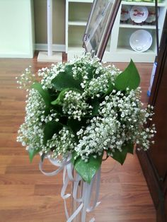 Unique bouquet of Babys Breath and greens ONLY.