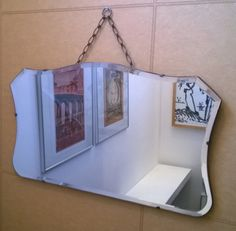 Vintage wall mirror bevelled edge Art Deco 1930s Thirties large looking glass shield shape overmantle or dressing mirror
