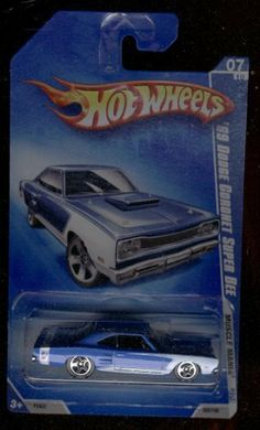 Hot Wheels 2009-07/10 '69 Dodge Coronet Super BEE 083/190 Muscle Mania 1:64 Scale by MATTEL. $1.50. MUSCLE MANIA. 1:64 Scale Collectible Die-Cast Car. 2009. 1969. Blue colored with white stripes details.