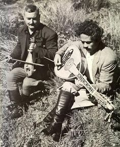 Cretan musicians playing the lyra and the lute.
