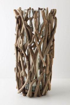 Driftwood hurricane, $78, Anthropologie  anthropologie.com...i have been gathering some sticks in the backyard w/Preston and just might make one of these!