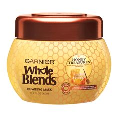 """Garnier Whole Blends Honey Treasures Repairing Mask: Honey, royal jelly, and propolisrestore weak strands. """"The differences makes the…"""
