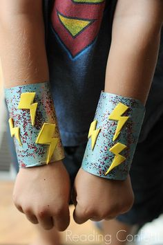 Make super hero cuffs from an empty paper roll...for my superhero writing theme