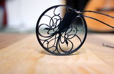 Hey, I found this really awesome Etsy listing at https://www.etsy.com/listing/52590897/black-art-nouveau-squid-necklace