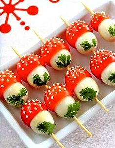 quail's eggs topped with dotted grape tomatoes and added small parcley leaf