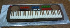 Piano cake - I made this birthday cake for Jason's dad. The white keys are made from white chocolate KitKats. The black keys and speakers are made from melted and rolled out Tootsie Rolls. The buttons are Do...