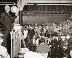 Harry S. Truman waving from back of train, whistle-stop tour, 1948.