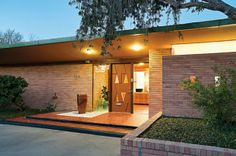 Photo: The Brady home is the real deal, an original Mid Century Modern design, evident from front to back with it's brick, glass and tile entry and the original unique front door. - Corpus Christi, TX | Corpus Christi Caller-Times