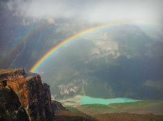 Rainbow over Lake Louise from the top of Mt. Fairview - Alberta, Canada