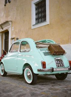 Fiat 500 convertble! Not normally keen but do love this one in the colour. Not convertible as not really practical in this country!