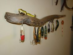Find driftwood to hang old fishing tackle. Maybe add an some fishing net