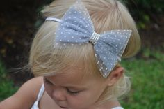 Like this unique elegant hair bow...pretty center, and light airy material choice.