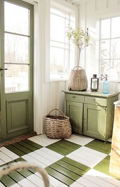 Cute checkerboard floor cheers up a modern country house mudroom...