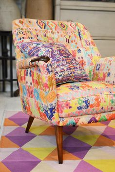 We love this chair re-upholstered in Guatemalan fabric, possibly made from recycled vintage huipiles!