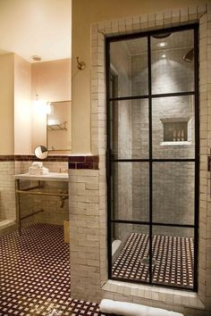 The Greenwich Hotel - bathrooms - steel glass paned shower door, steel glass shower door, stone