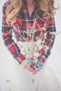 I love a girl who can rock a flannel and a wedding dress. It proves to be an amazing combo in this snow-filled Bridal shoot captured byApples & Honey Photography. It's so cute it almost, almost has me wishing for one
