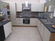 Image result for kitchen wall tiles with black worktop