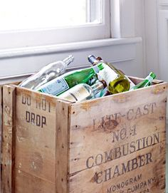 A Budget-Friendly Kitchen Makeover-Even recycling bins deserve a little soul. Why live with an unattractive plastic trash can when a crate brings character to the task? Read more: Cheap Decorating Ideas - Kitchen Makeovers - Country Living Smart Storage, Bin Storage, Crate Storage, Recycling Bins, Plastic Recycling, Recycling Center, Recycling Ideas, Plastic Bins, Freundlich