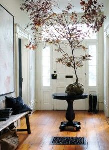 love a circular table with a vase of flowers, a tree is something unexpected!