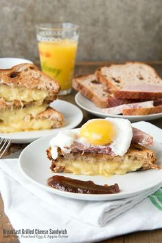 Breakfast Grilled Cheese Sandwich with Ham, Poached Egg and Apple Butter, on Cinnamon-Raisin Bread! Great for any meal, and gluten-free or regular bread!