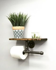 Are you looking for a unique bathroom piece? We have it!! This modern, rustic double toilet paper holder with shelf is a practical combination of 2 things in one. We have a storage for two toilet paper rolls with an extra shelf for holding a small flower pot, picture frame, book, candle and #bathroomtoiletmodern