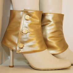 Wear these spats with your shoes or boots to change the look instantly and make a unique fashion statement.Created out of gold vinyl salvaged from a jacket and lined with a black and gold striped fabric.  Closes on the side with vintage gold buttons.