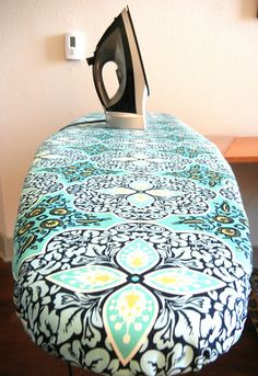ironing board tutorial. I don't see the point in cutting it down the middle, but I'll try it!
