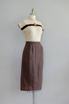 Military-esque wool dress from the early 40's, love this, once again, I'm taking fashion advice from my favorite Character from a book ever, Livvy!
