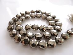 1/2 STRAND Faceted Pyrite Coin Nuggets by norah62 on Etsy, $19.99