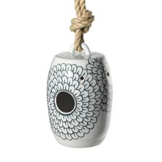 MQuan Studios designed this porcelain birdhouse with its future inhabitants in mind.  Inspired by a Japanese lantern, each piece is hand thrown and painted with a chrysanthemum flower design that unfolds outward from the opening, and continues to wrap around the structure giving it a blossoming effect.