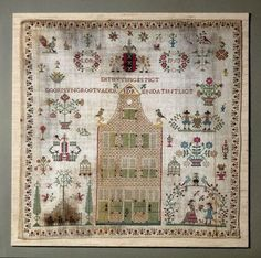 antique sampler. have loved it since i first saw it on an antique sampler site, along with other houses with green doors and shutters.  wish someone would reproduce it!