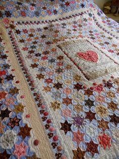 """Supergoof Quilts: """"The SPARKLERS QUILT"""". Look at the yo-yo's and appliqued hearts in the inner border."""