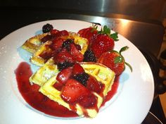 Lemon Coconut Belgian Waffle Topped With Berries And A Berry Syrup