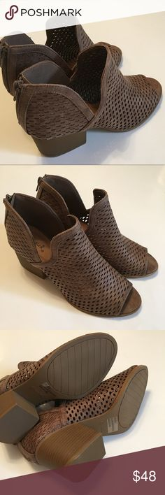 Perforated cut out peep toe booties fits like 9 Dark taupe. Reposh d/t didn't fit. Never worn just tried on.!IMPORTANT these run 1/2 size large. Size 8.5 but will fit 9. Runs wide so not best for narrow feet. Comfortable! 2 inch block heel. These are selling out in boutiques all over posh. I have box but it's a little damaged. Qupid Shoes Ankle Boots & Booties