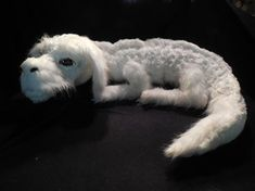 Falkor plush luck dragon from The Neverending Story on Etsy. It's been sold, so not available, but WOW. Dragon Pet, Baby Dragon, Elfen Fantasy, Fantasy Art, The Neverending Story, Glitter Paint, Cultura Pop, Stuffed Toys Patterns, Looks Cool