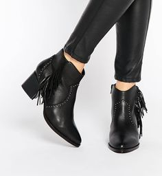Boots by ASOS Collection Real leather upper Silvertone stud detail Fringe  styling Side zip fastening Pointed toe Midheight stacked heel Treat with a