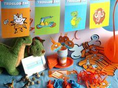 CAJA TEMÁTICA DE TROGLODITAS - Todo lo que necesitas para la decoración de tu fiesta infantil o cumpleaños temático: guirnaldas, globos, caretas, medallas, vasos personalizados, pajitas, manteles, … y mucho más. ¡¡Celebra tu cumpleaños infantil personalizado más original y divertido!! $40.80
