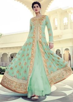 #NargisFakhri 7318 aqua(sea green) color #anarkali suit is on pure georgette fabric with net flare with golden zari, sequins and stone work. Rayon bottom and chiffon dupatta.